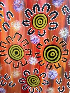 Aboriginal artwork yellow orange black white dots circles flowers
