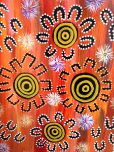 Aboriginal artwork yellow orange black white dots circles flowers