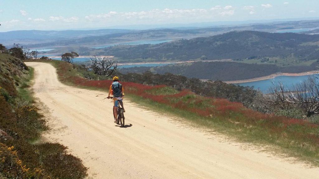 rider on fire trail above lake eucumbene
