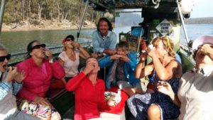 seven people eating oysters on oyster boat