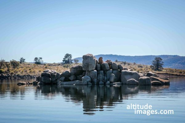 curiosity rocks above water line in lake jindabyne