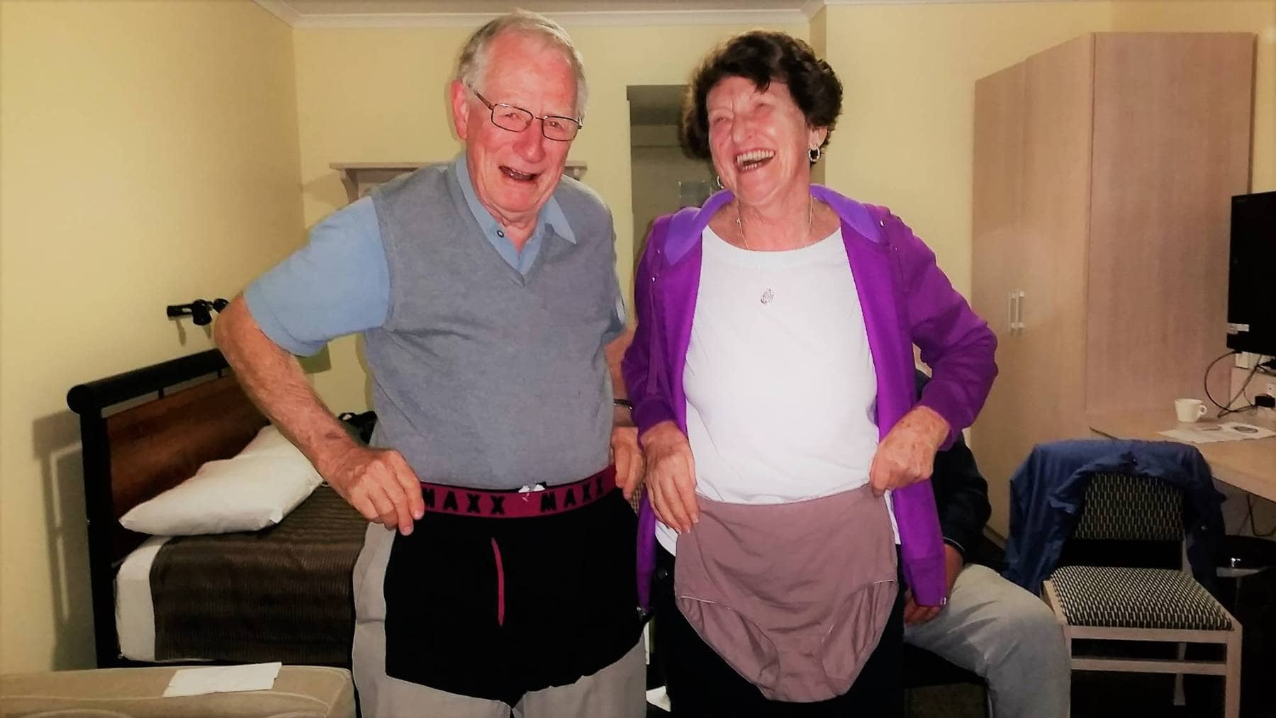man and woman holding up undies and laughing