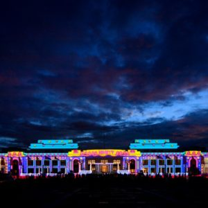 old parliament house canberra lit up with multi colour lights