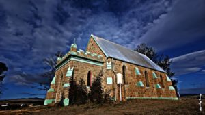 catholic church at dalgety against a stormy sky
