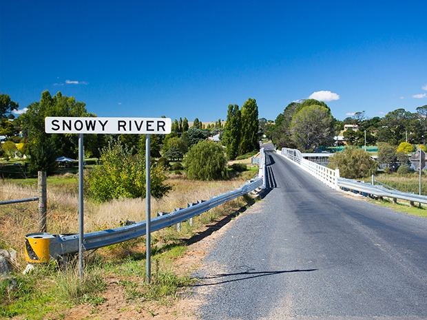 the snowy river sign and dalgety bridge with town in the background