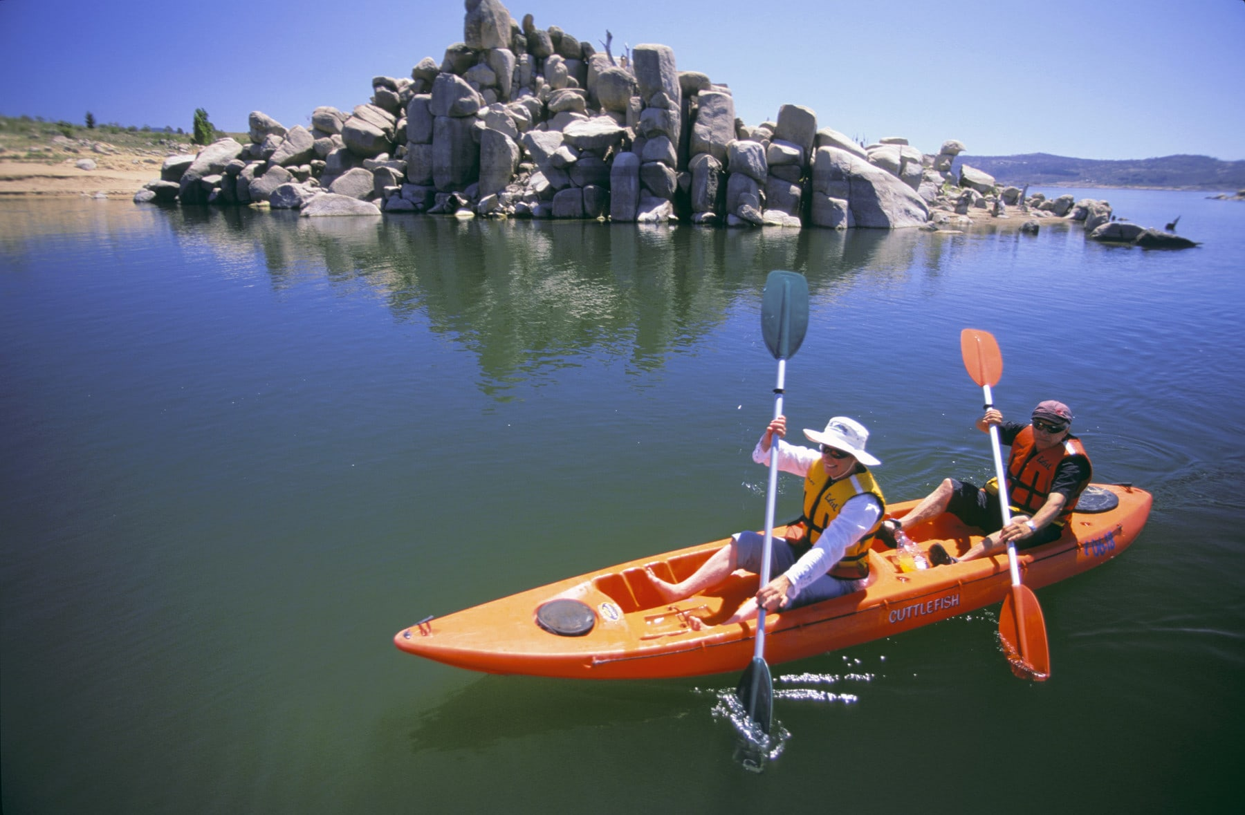 two people in a canoe on lake jindabyne