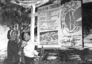 circa 1960 two women looking at a thredbo trail map