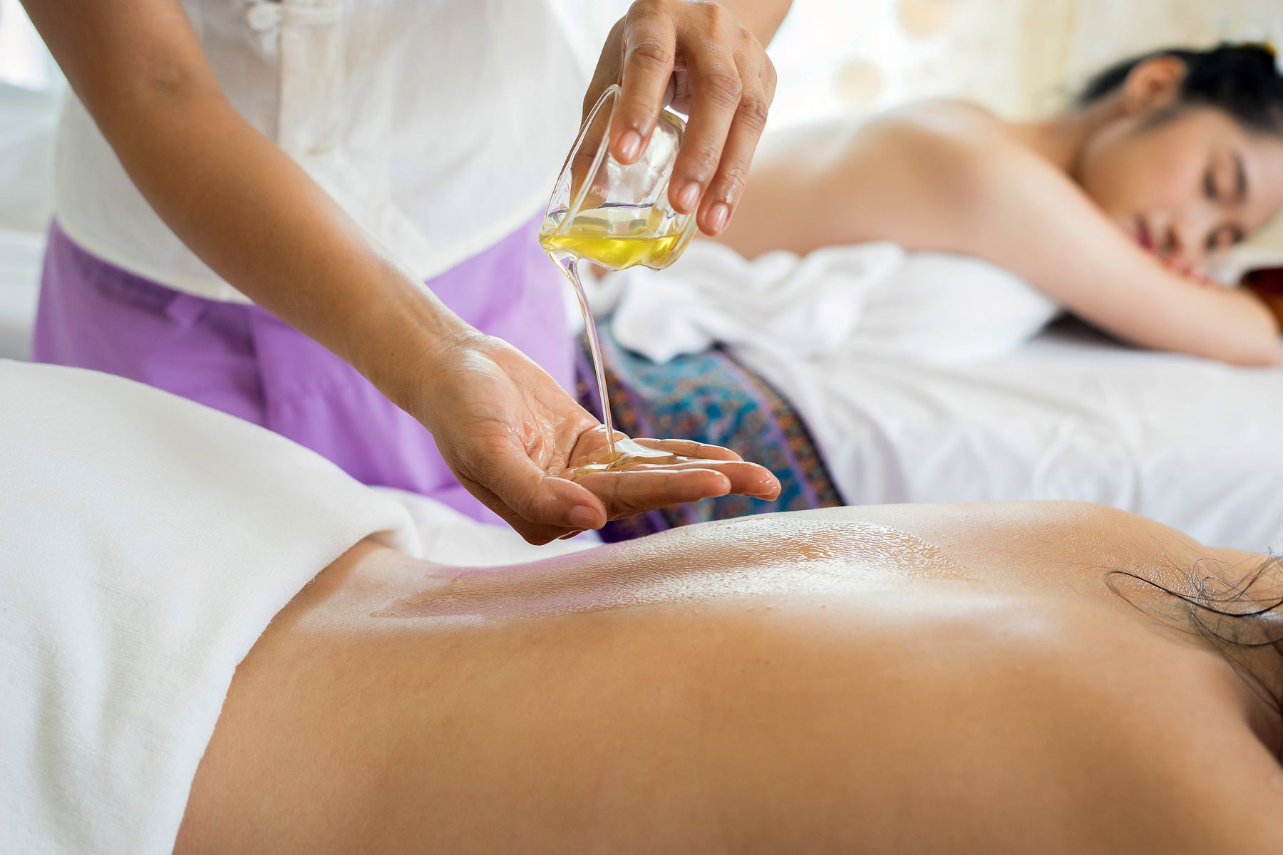 two women on massage tables at a day spa