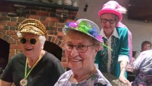 three women with colourful hats