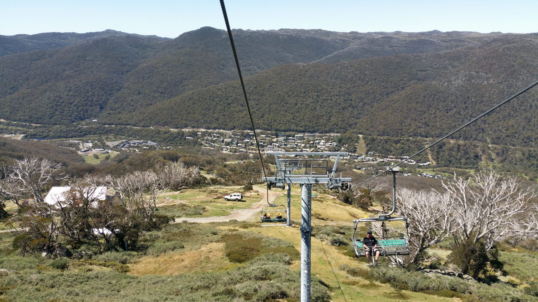thredbo village with mountains behind as seen from the chairlift