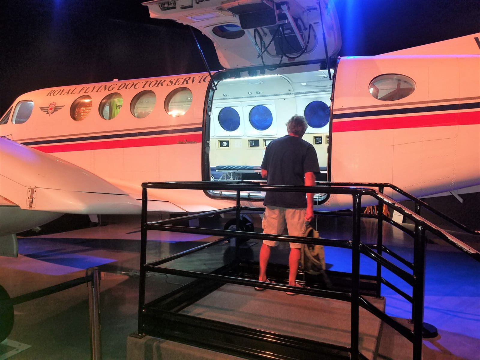 man looking inside small airplane