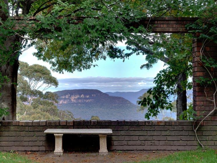 stone seat overlooking spectacular sandstone valley