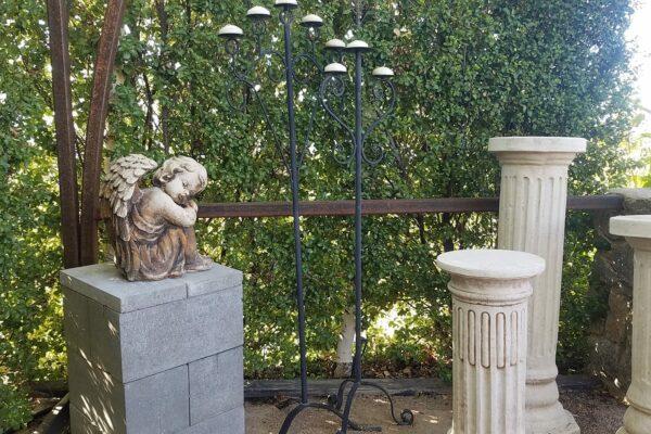 garden statue of pillars and cherub