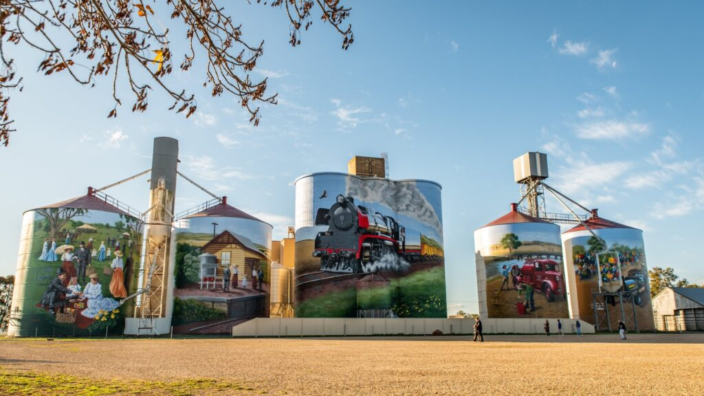 several brightly painted silos