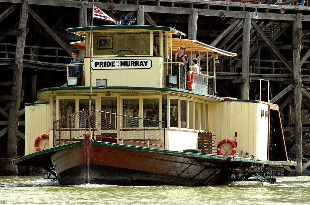 paddle steamer in front of wharf